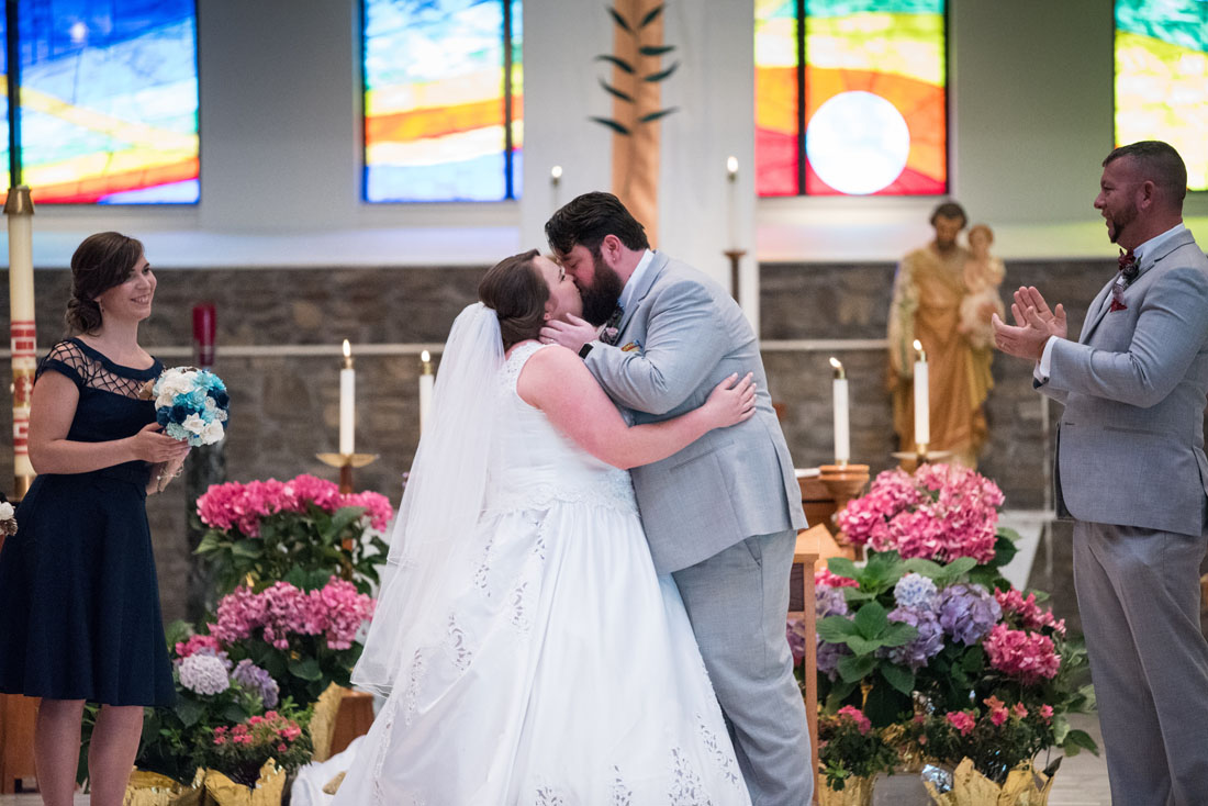 Ashley & Paul seal their vows with a passionate kiss.