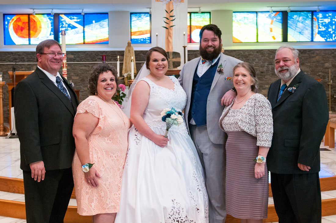 Her dad & mom, Ashley and Paul, and his mom and dad.