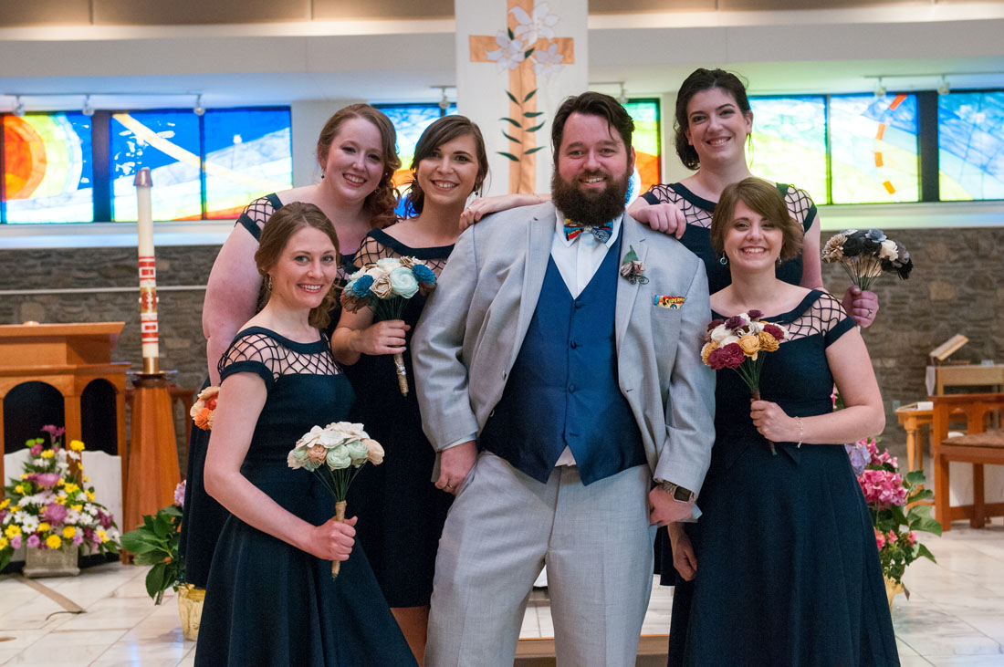 Paul, chillin', surrounded by bridesmaids.