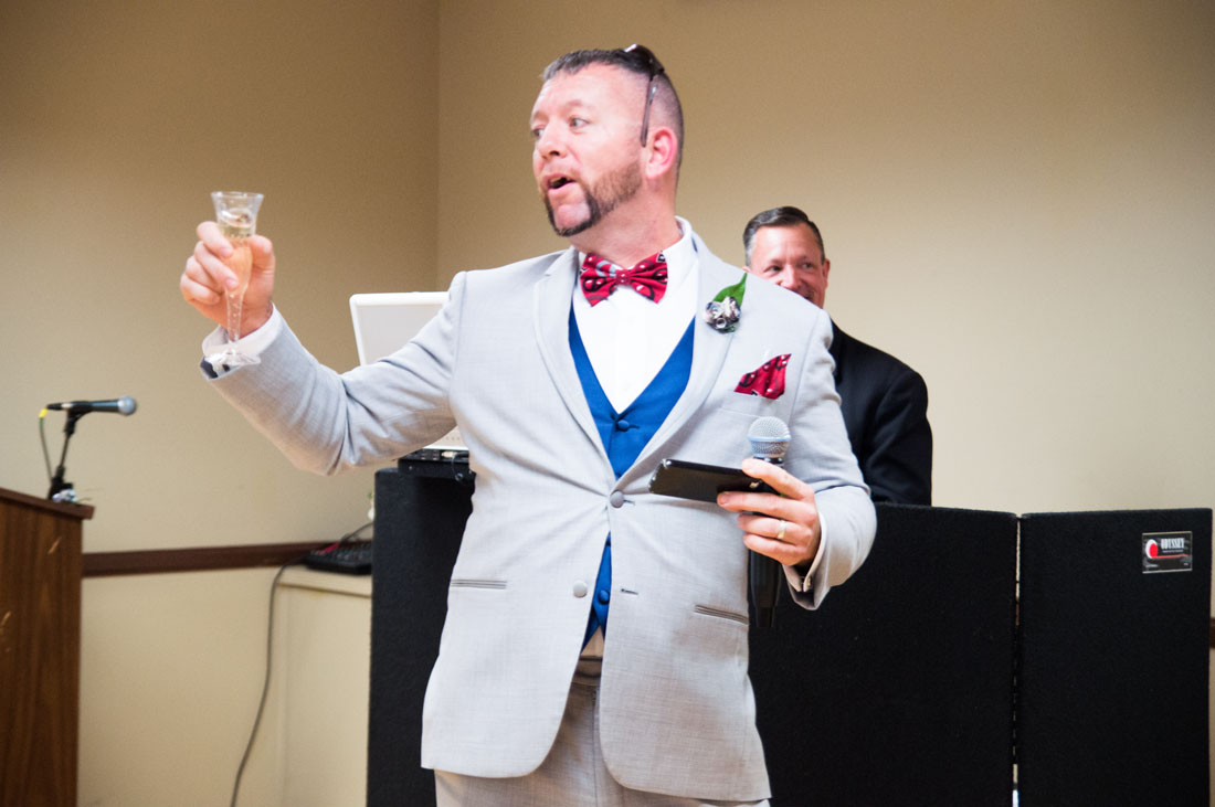 The best man gives an animated toast.