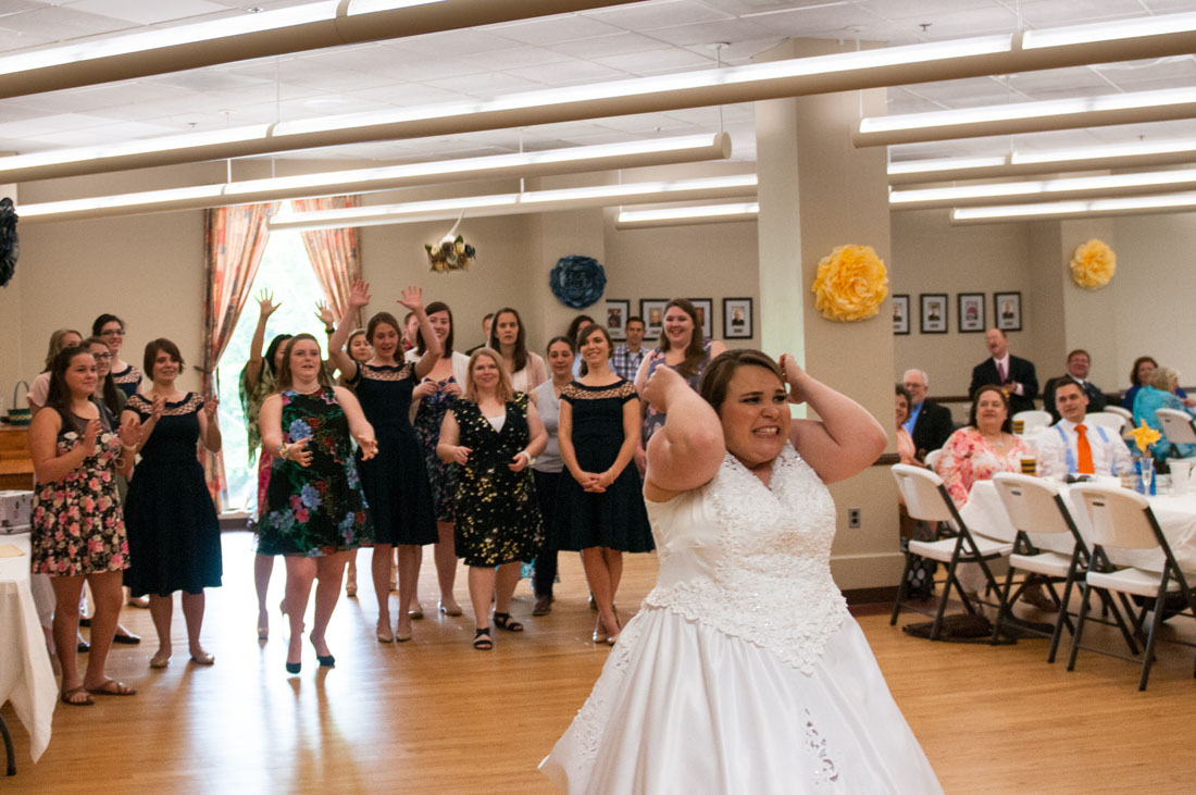 Ashley grimaces as she releases the bouquet.