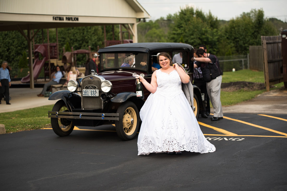 Notice the groom and groomsmen push-starting the car. Hey, it's old.