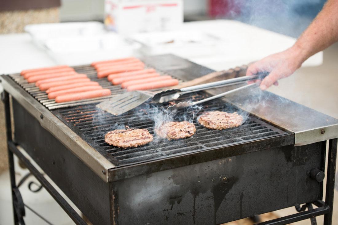 Hamburgers & hotdogs on the grill.