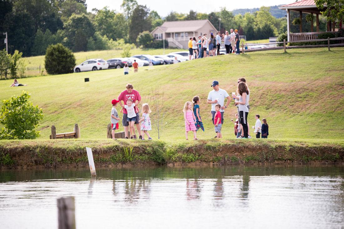 Kids playing beside the pond - FUN!