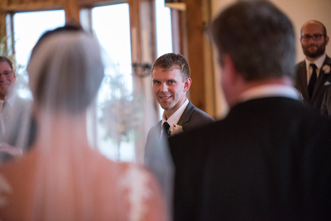 Groom getting a good look at the bride being escorted by her father. MUST HAVE SHOT!