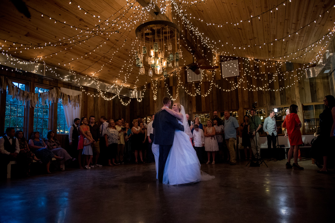 Bride & groom share their first dance. We love it when the guests give space for this moment.