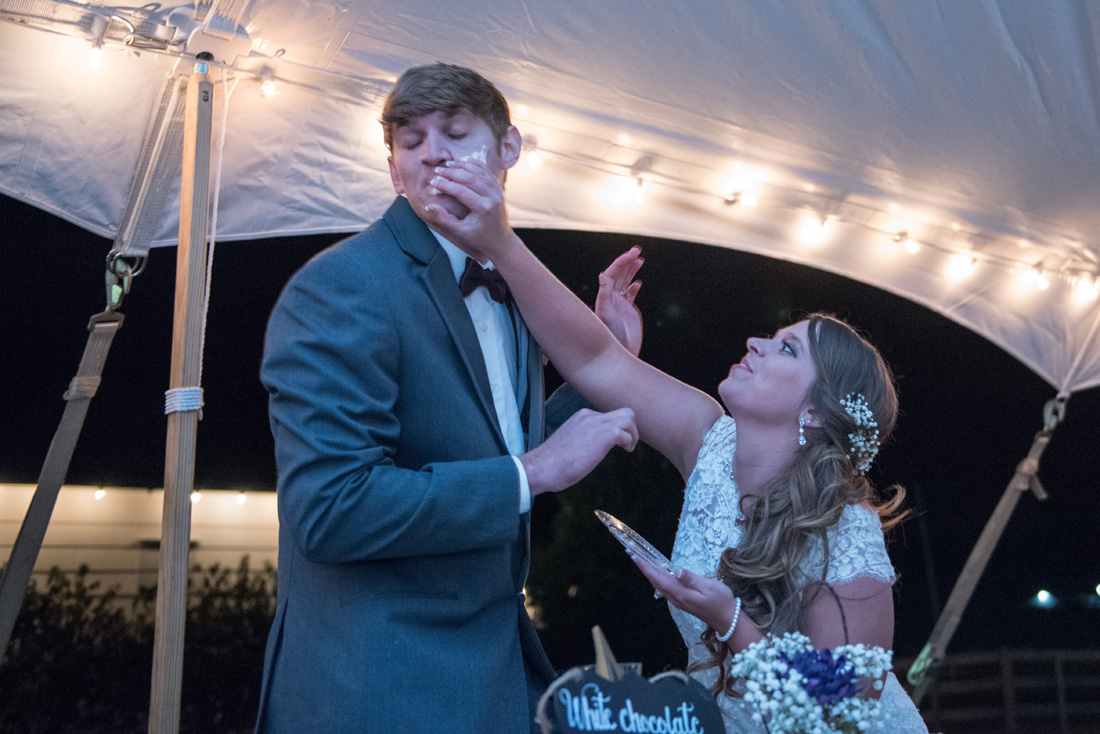 Bride smashes cake in the groom's face!