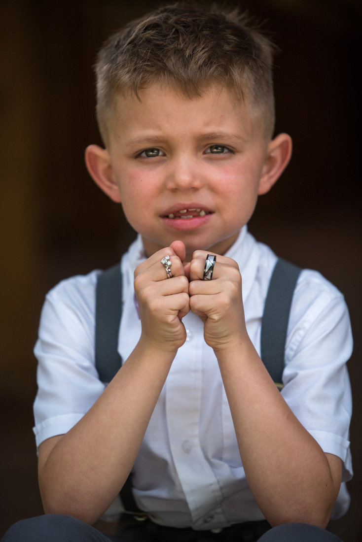 Cutest ring bearer ever!! Look closely at the wedding ring - sublte Mickey Mouse Icon again.
