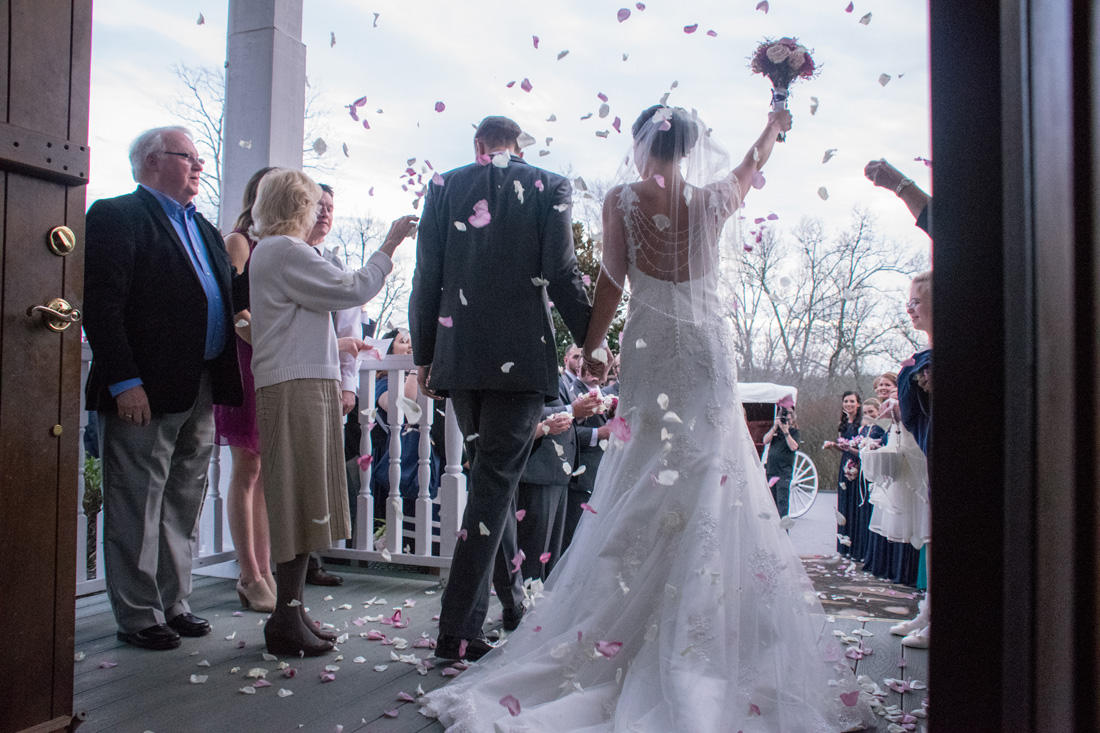 Sarah & Matt are showered in rose petals as they leave the church.