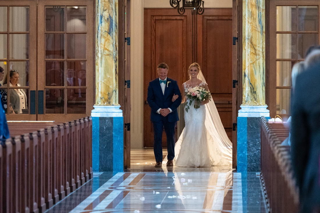 Doors open to reveal a proud father & stunning bride