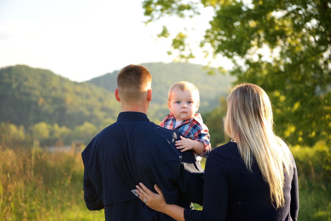Family photo of dad, little boy & mom