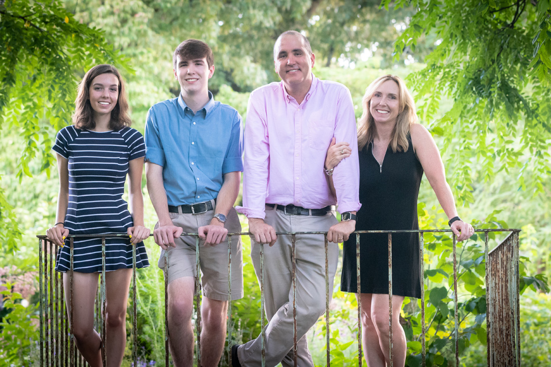 Family photo of teenagers with parents