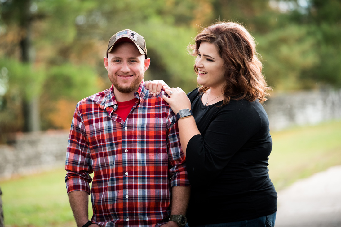 engagement photo of engaged couple with huge grins