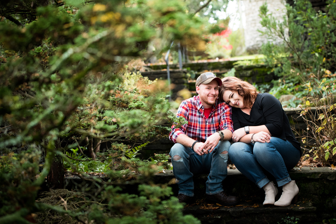 engagement photo of engaged couple snuggled up on steps