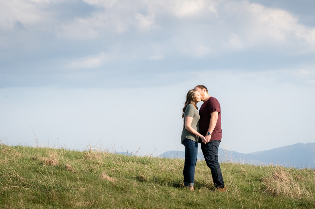 engagement photo of engaged couple high atop a mountian