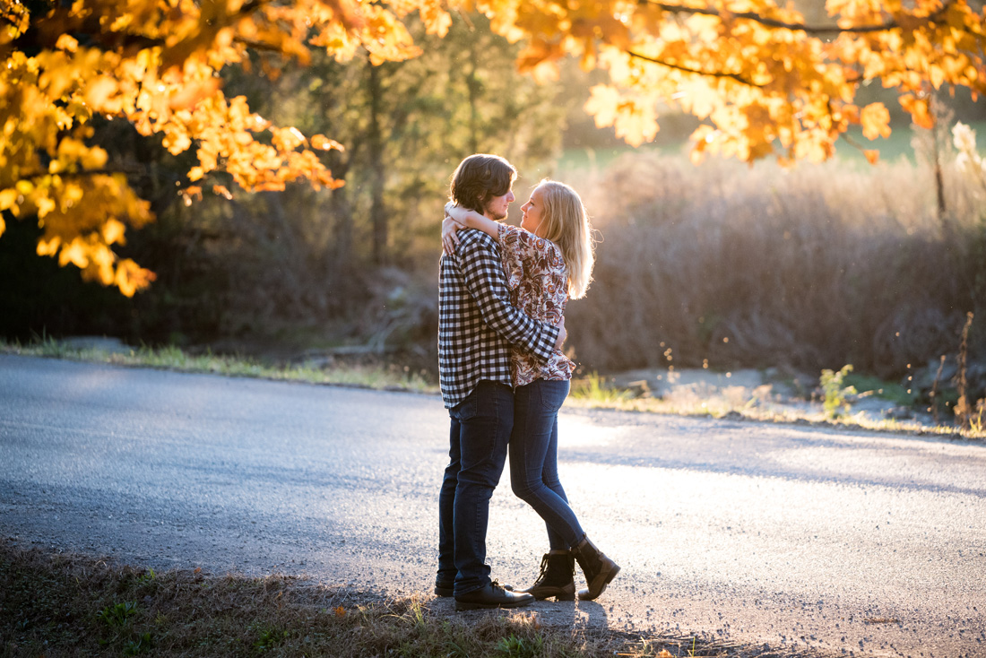 engagement photo of engaged couple under fall color
