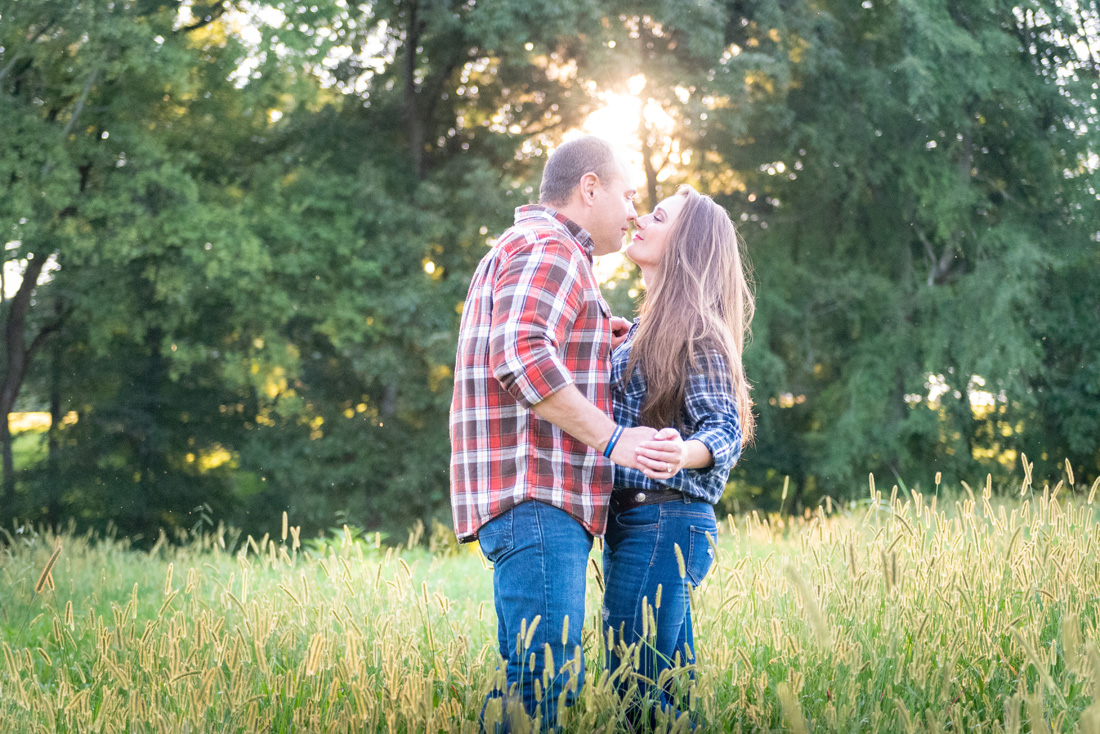 engagement photo of engaged couple in deep gold grass