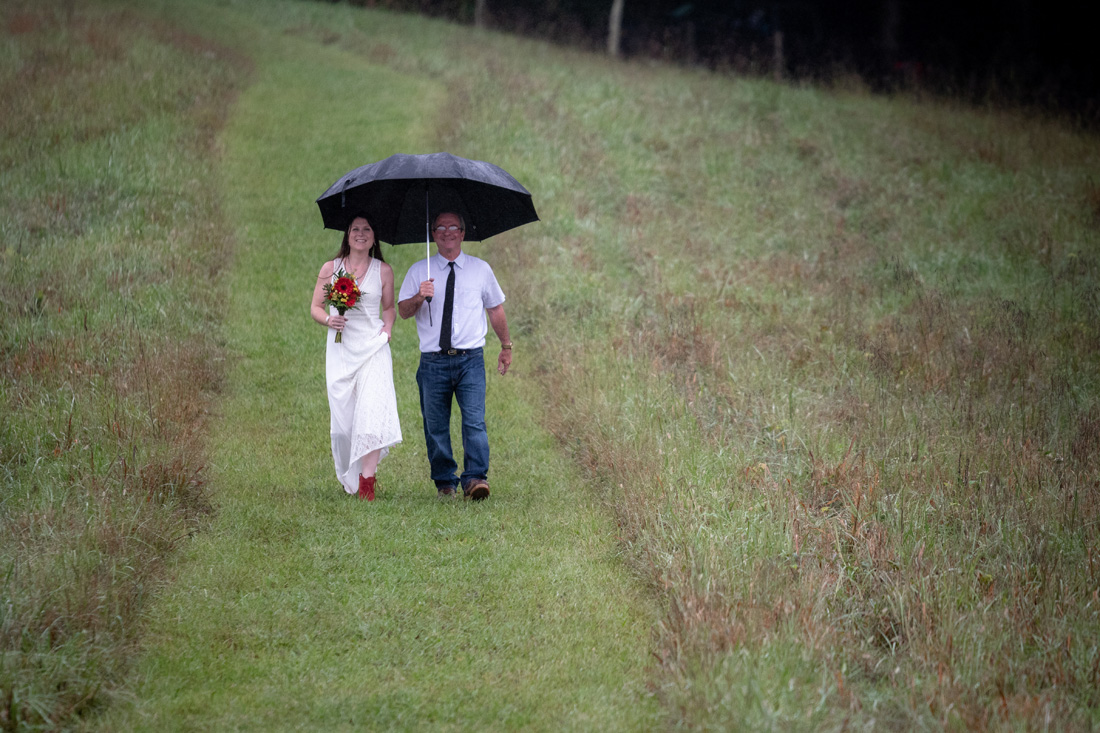 Rain can't stop Megan and her father from making a grand entrance! All smiles all the way!!