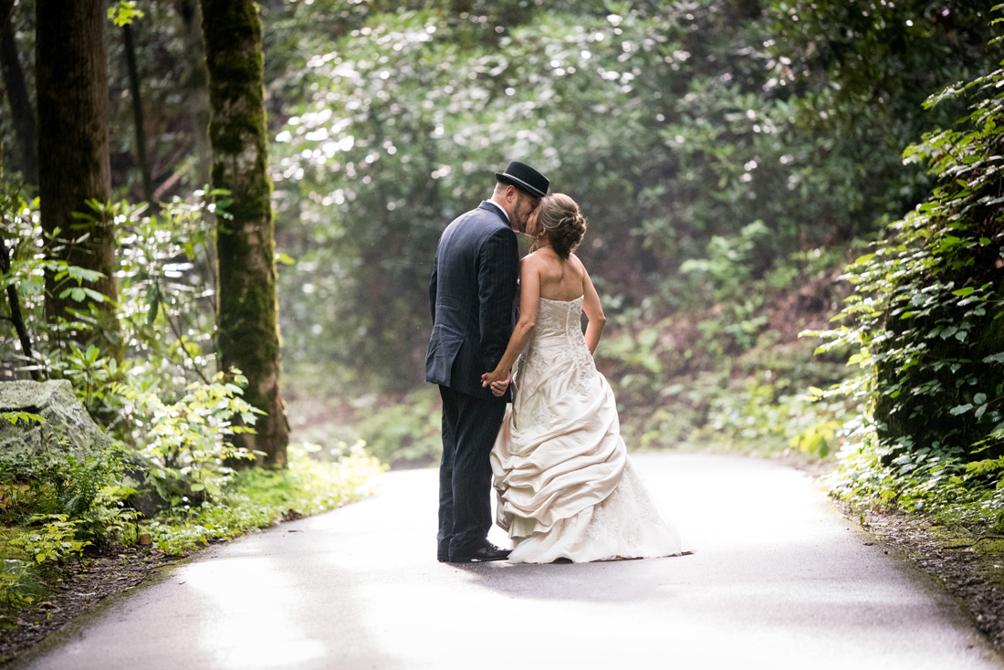 Bride & groom walk along a quiet road and stop for a kiss!