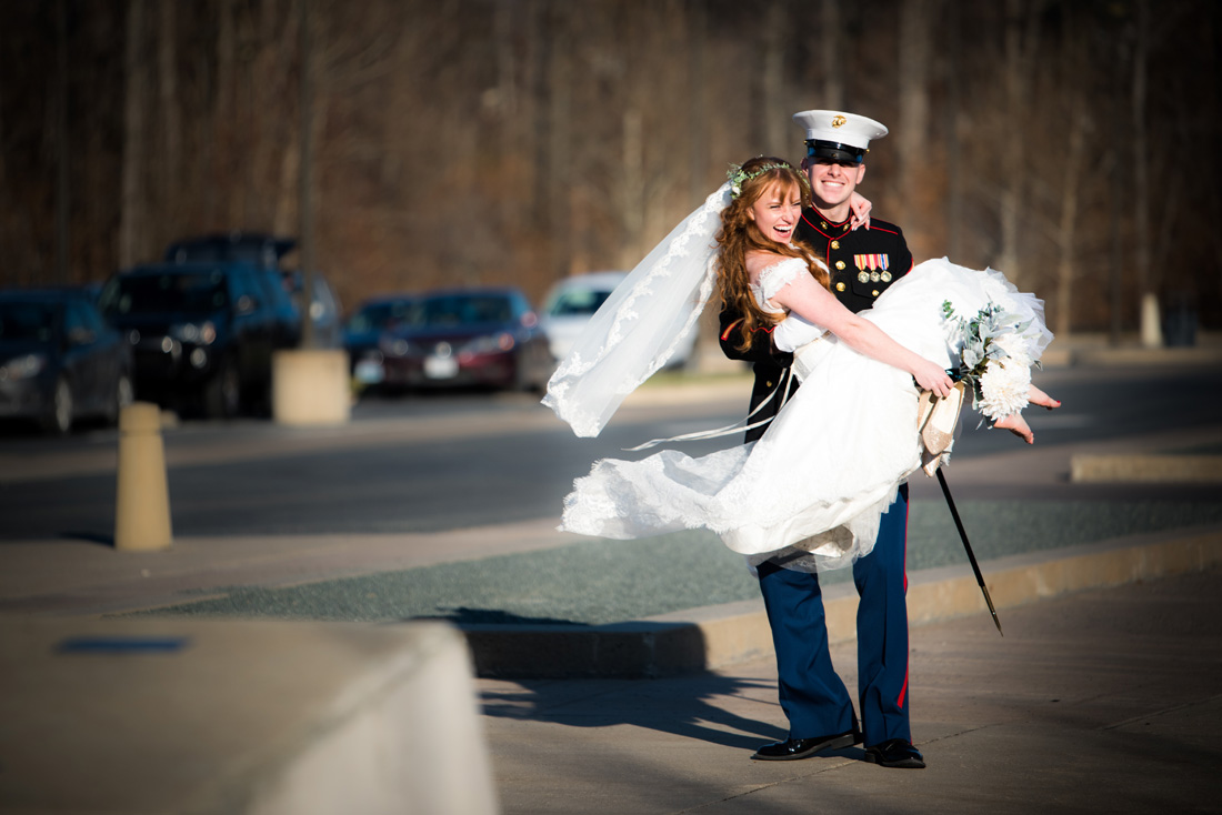 Bride being carried by her marine officer groom!!!