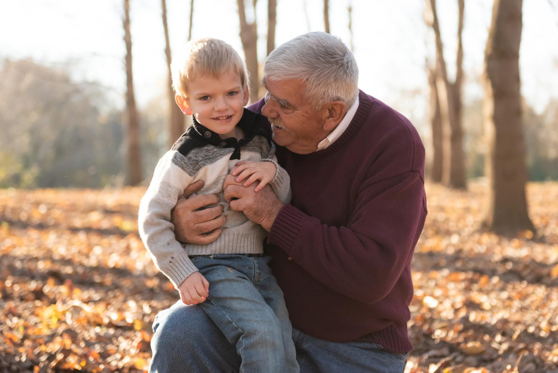 Family photo of little boy & grandpa