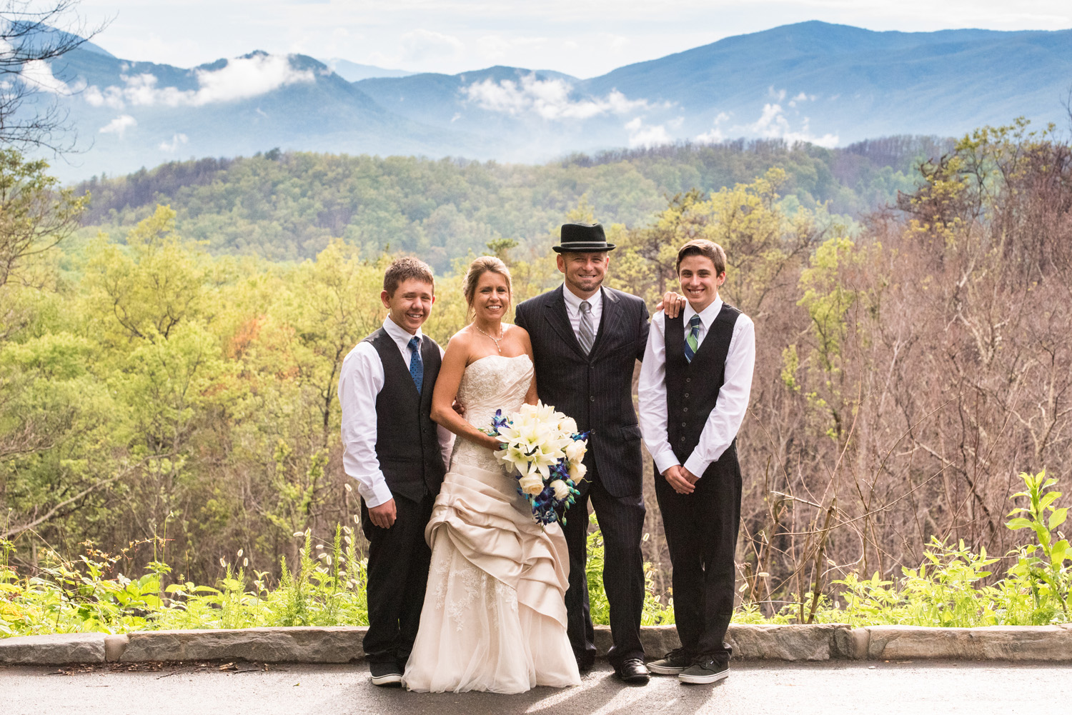 Bride & Groom with kids with Smokies in the background.