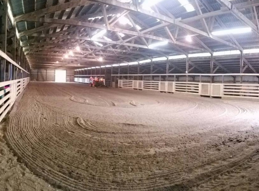 Our 50' x 200' indoor arena and main barn.