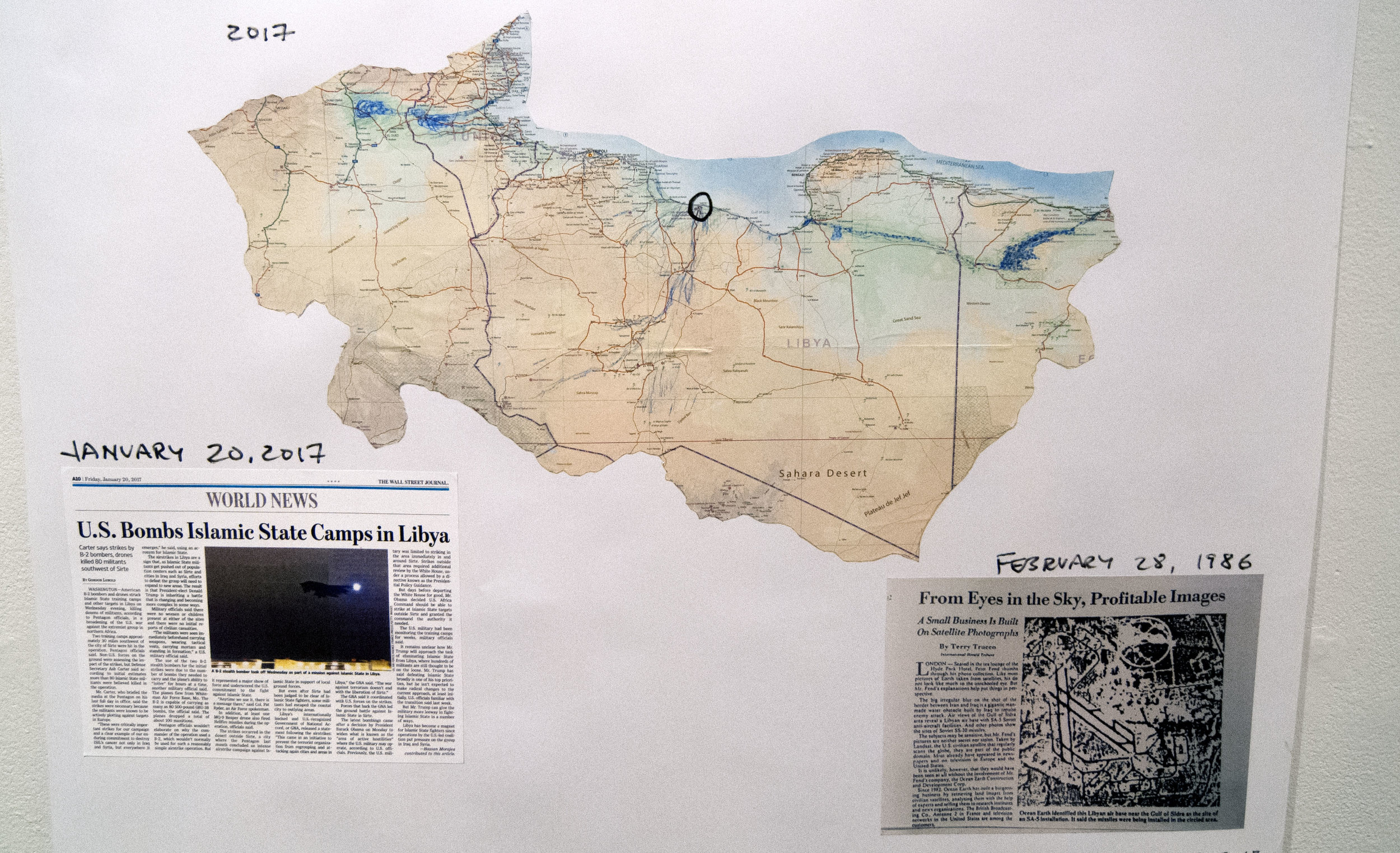 """First subject for Shadow Defense Secretary, due to WSJ news article on our first day, January 20, 2017. The site of bombing by two B-2s was studied by the Shadow Defense Secretary in Spring 1986. A record of this exists in the book """"Ocean Earth,"""" including a drawing made in 1986 noticing a """"gap"""" between the wadi (ephemeral river-bed) there and the Sea. An image of the air base, not showing the SAM-5 sites, was published in the International Herald Tribune article about Ocean Earth, February 26, 1986. The site is in the middle of a larger sea-basin concavity, that of the Gulf of Sirte and its immediate coastal outflow.The blue and green markings show sub-sea-level troughs near the Sea which Ocean Earth proposes to flood."""