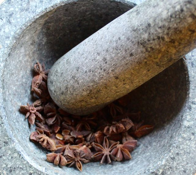 Mortar & pestle used for breaking up spices.