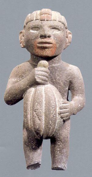 Aztec sculpture holding a cacao pod (Attribution:  http://www.latinamericanstudies.org/aztec-figures.htm )