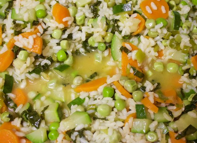 Stir constantly to move the rice around in the broth and cook until the broth is absorbed.