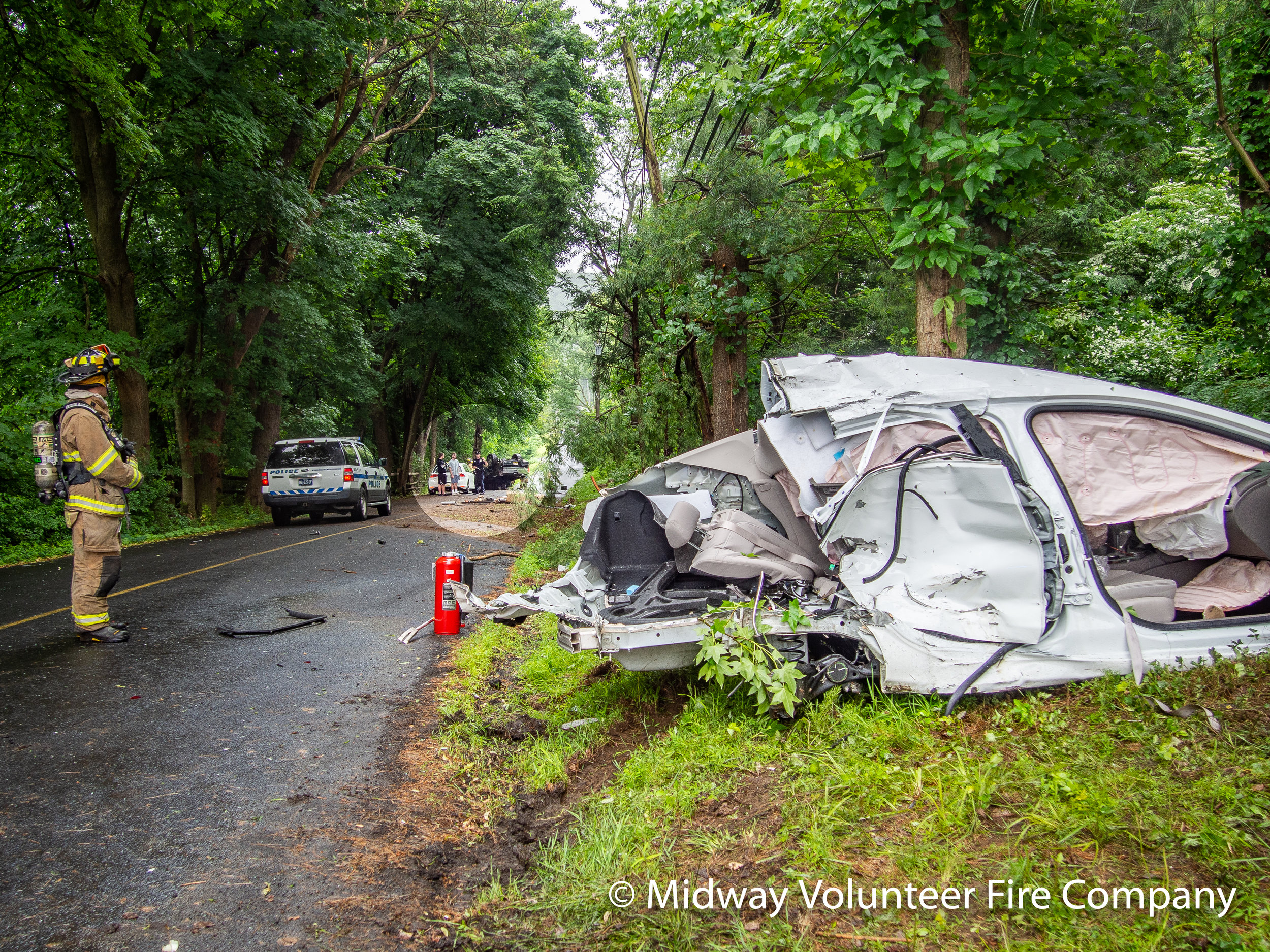 2019.06.10 - Rescue 5 and Engine 15 respond to a two vehicle accident on Holicong Road at Upper Mountain road. Three people transported to area hospitals after being extracted. The accident involved the white vehicle in the foreground and the overturned truck in the highlight circle. The other white car was not involved.
