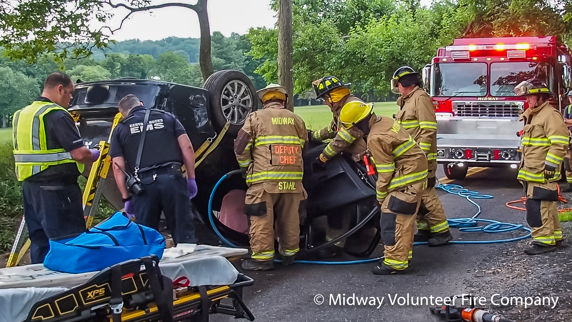 2019.07.03 - at 6:26AM Midway's Rescue 5 and Central Bucks EMS responded to an auto extraction on Green Hill Road, near Mechanicsville Road in Solebury Township. It took crews less than 6 minutes create an opening to remove the single occupant, who was then transported to an area Trauma Center. No additional information on driver's condition or cause is available at this time.