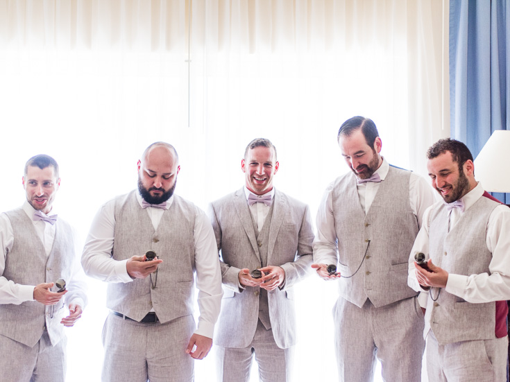 Groomsmen enjoy their pocket-watches at this destination wedding in Mexico