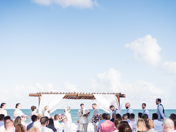 stunning destination wedding facing the caribbean ocean in cancun mexico.