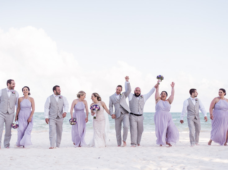 Purple and grey wedding colors for this stunning and flawless beach wedding in Cancun Mexico.