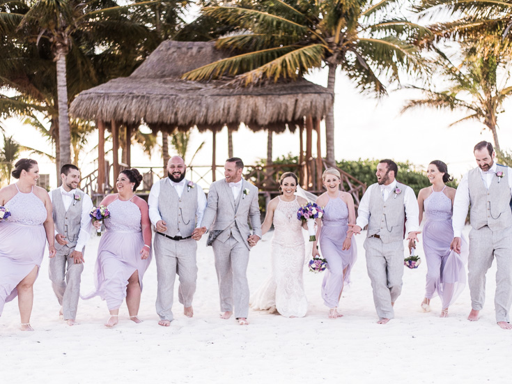 Such a fun bridal party hanging out on the beach in Mexico celebrating this destination wedding!