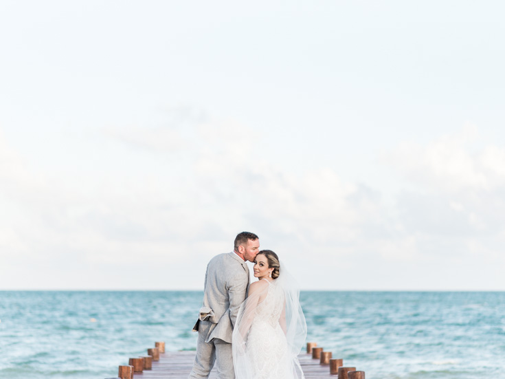 Gorgeous destination wedding photography overlooking the Caribbean Ocean in Cancun Mexico.
