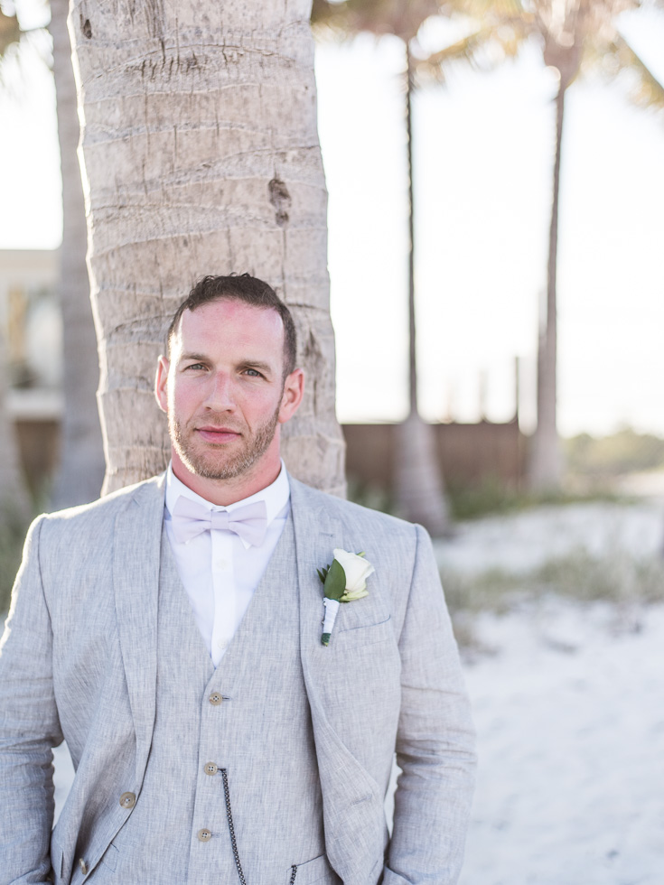 Groom wears three piece suit for his wedding day