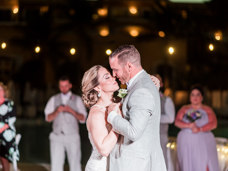 Couple enjoys first dance after their perfect destination wedding in Mexico.