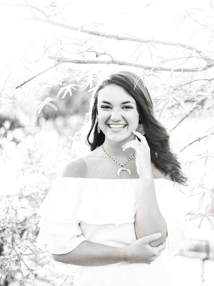 Spring senior photo shoot in a white dress on the Columbus Riverwalk in Georgia