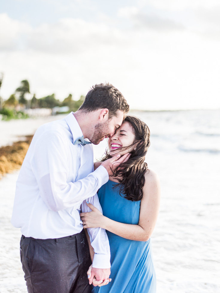 Happy Couple engagement photos on the beach