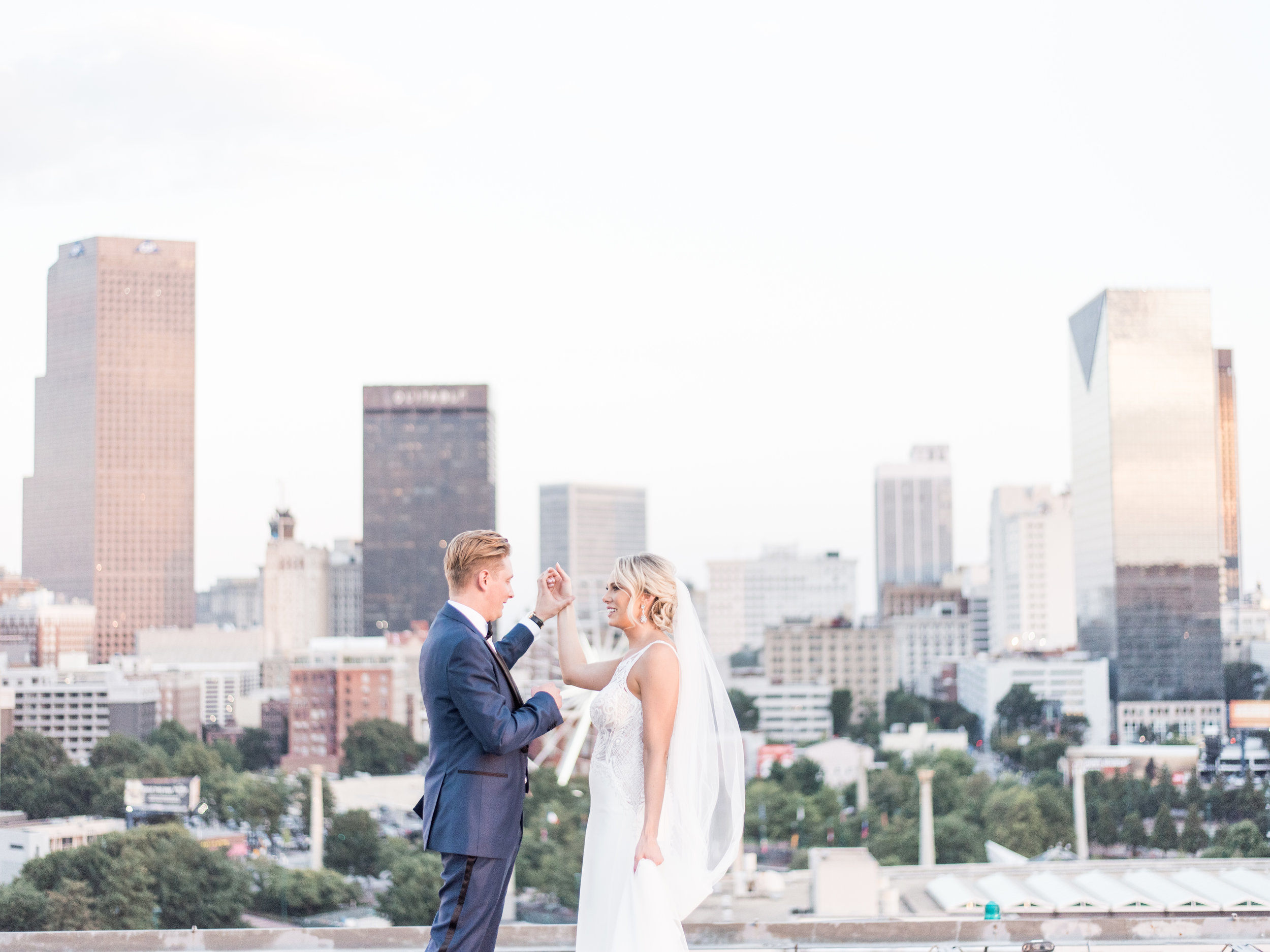 Summer rooftop wedding pictures in Midtown Atlanta