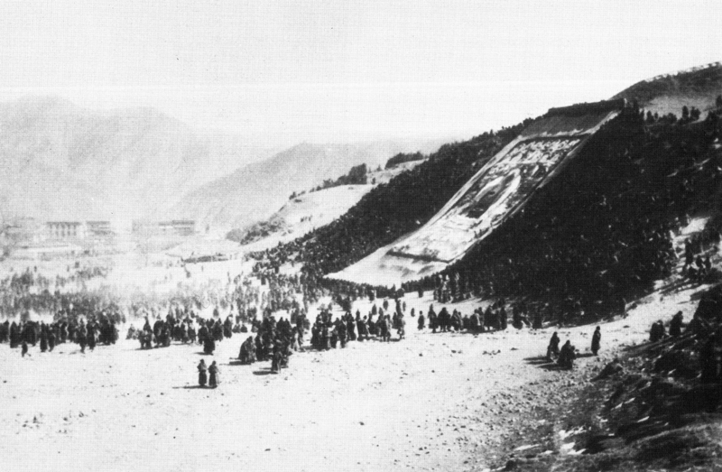 Large appliqué thangka unrolled on a hillside at Labrang in Amdo, Eastern Tibet, c.1930.