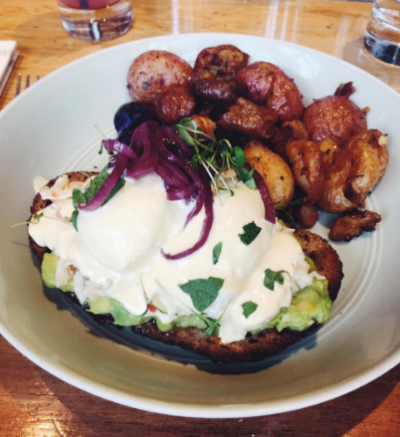 Eggs Benedict from  Cindy's – complete poached farm eggs, king crab, avocado!