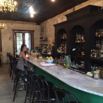 Sitting alone at the Bar at The Columns