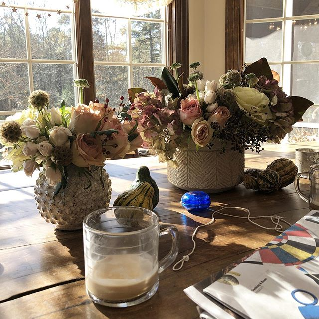 Day after thanksgiving table. Copious amount of coffee, the NYT, a yo-yo and of course flowers still looking happy 💛