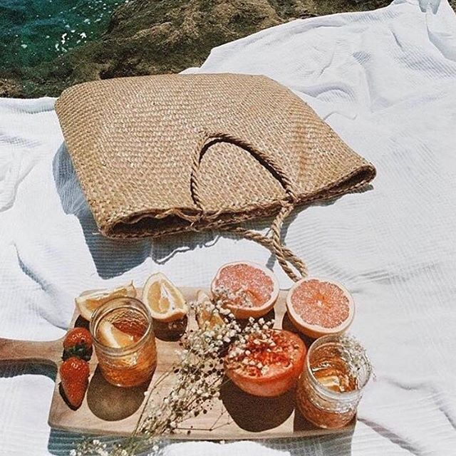 It's important to always carry sangria in your purse. Temper, too. . . . . . . #glide #sunset #picnic #bliss #surflikeagirl #sangria #beachhairdontcare #messyhairdontcare  #underwater #surf #surfing #glasslove #saveyourstrands #healthy #beachhair #explore #swell #travel #easyliving #relax #slideladyslide #longboarder