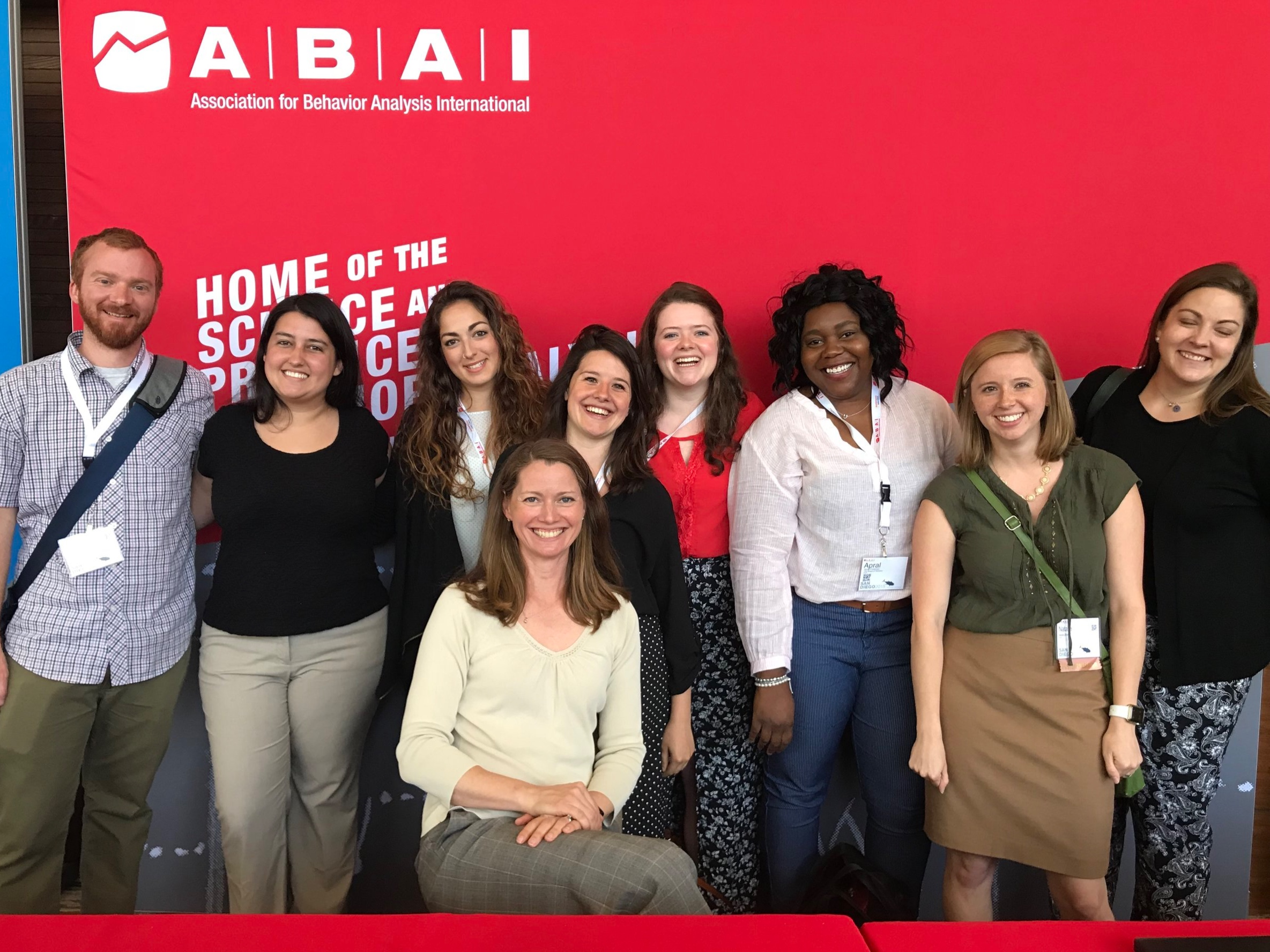 Current and former members of the lab get together at ABAI 2018. Left to right: Michael Mathews, Claudia Diaz-Salvat, Lucie Romano, Stephanie Jones, Catherine Williams, Apral Foreman, Natalie Shuler, and Aimee Giles (Claire, seated).