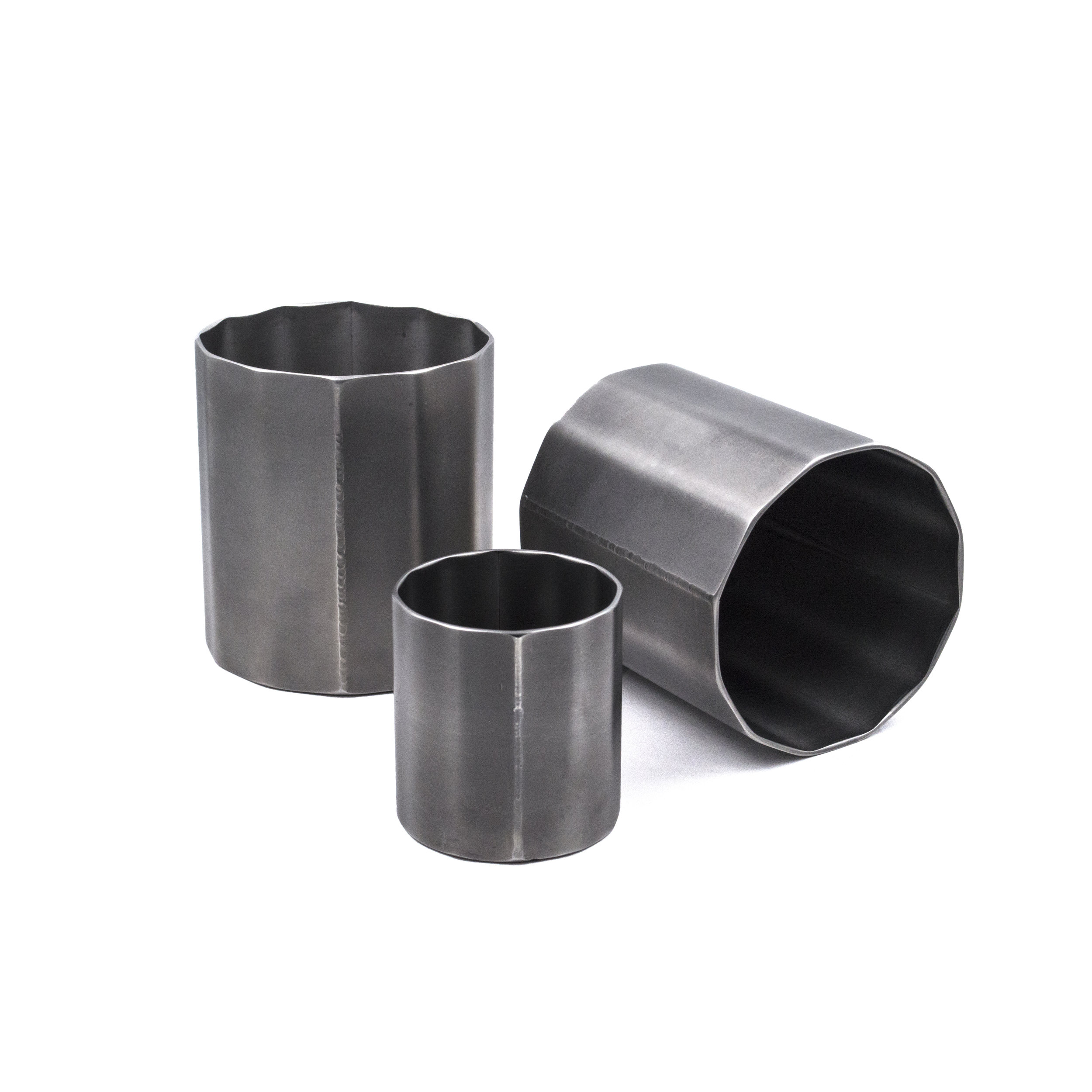 Stainless Steel Cocktail Tumblers Standard Tumblers: 3.25 x 3 x 3 in (10 fl oz.) Tall Tumblers: 4.75 x 2 x 2 in (10 fl oz.) Shot Glasses: 2 x 1.75 x 1.75 in (2 fl oz.)